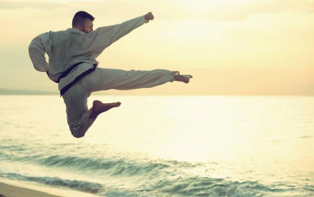 Man doing karate poses stock photo