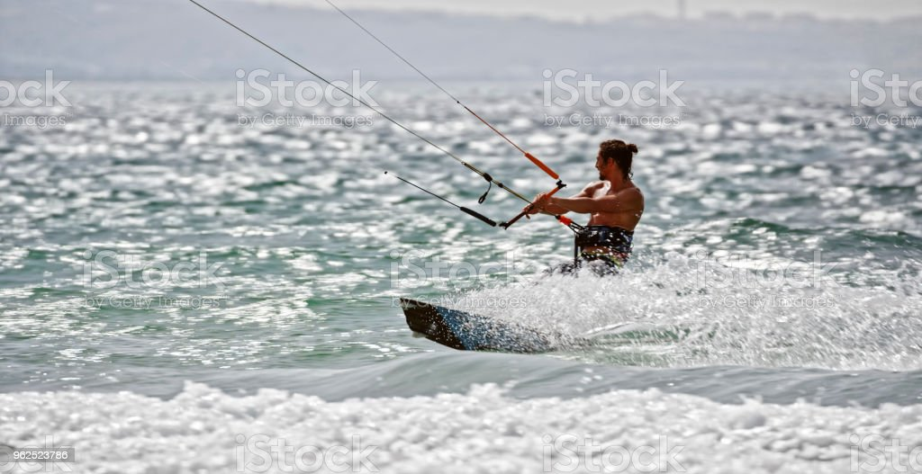 Man doing kitesurfing - Royalty-free 25-29 Years Stock Photo