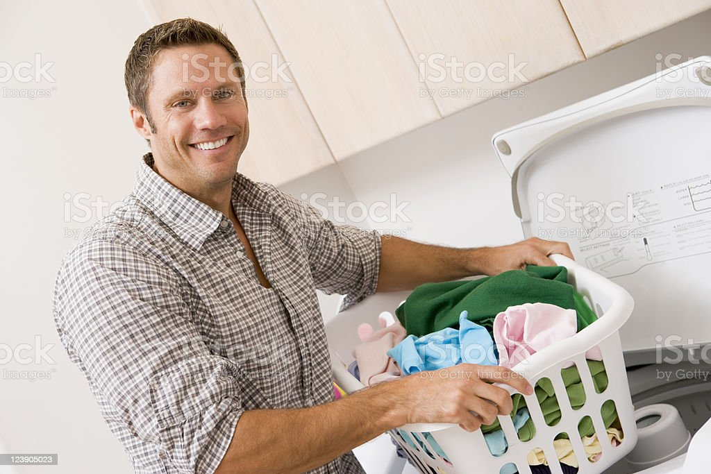 Man Doing Laundry - Royalty-free 40-49 Years Stock Photo