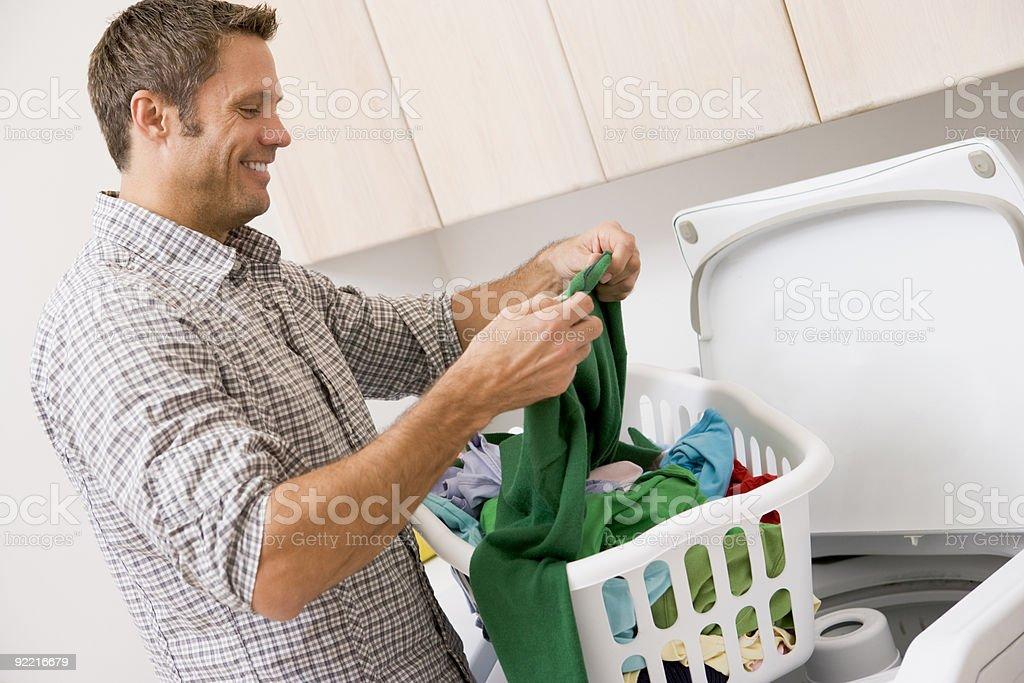 Man Doing Laundry royalty-free stock photo
