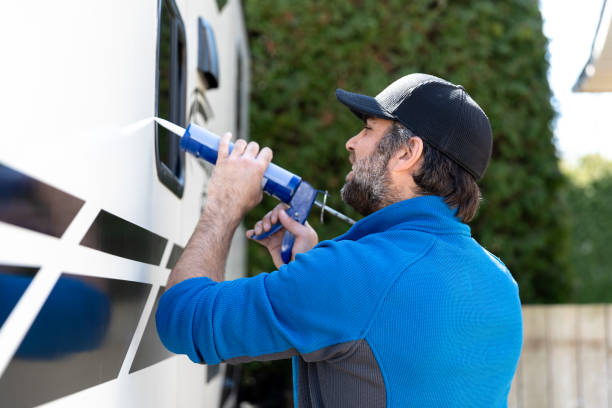 Man Doing Maintenance of Camper Trailer stock photo