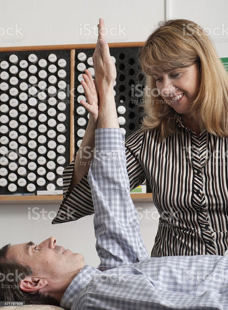 Man doing muscle response test with female stock photo