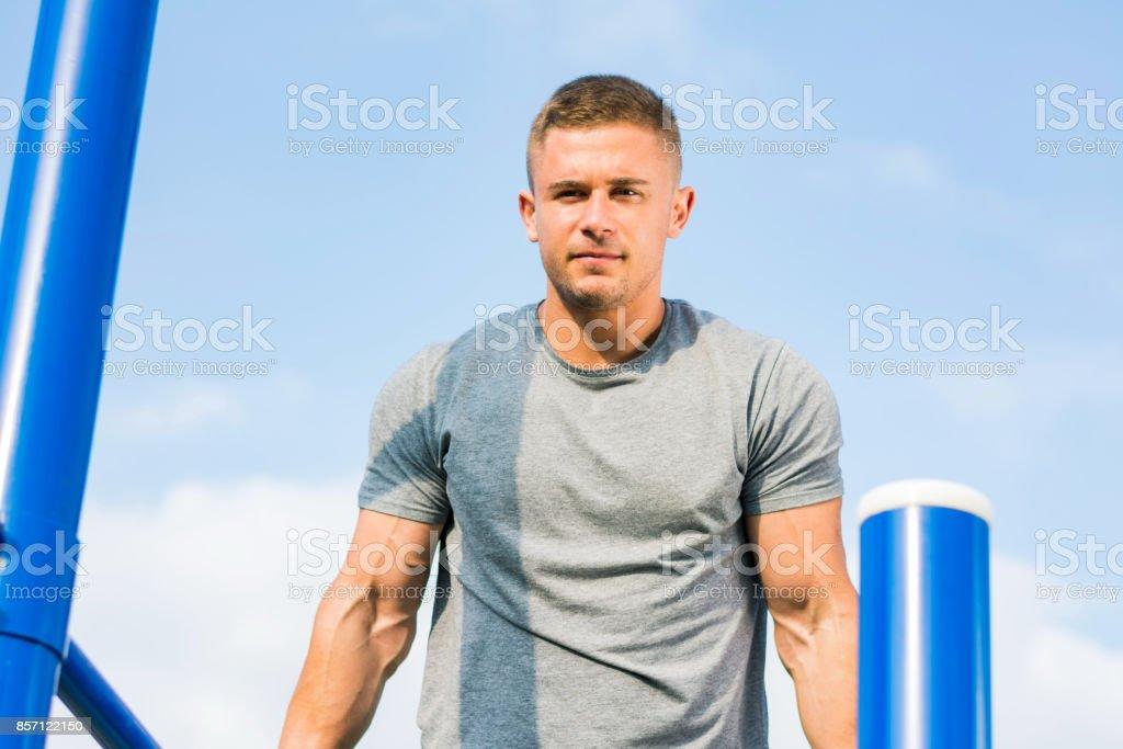 Man doing parallel bar dip exercise stock photo