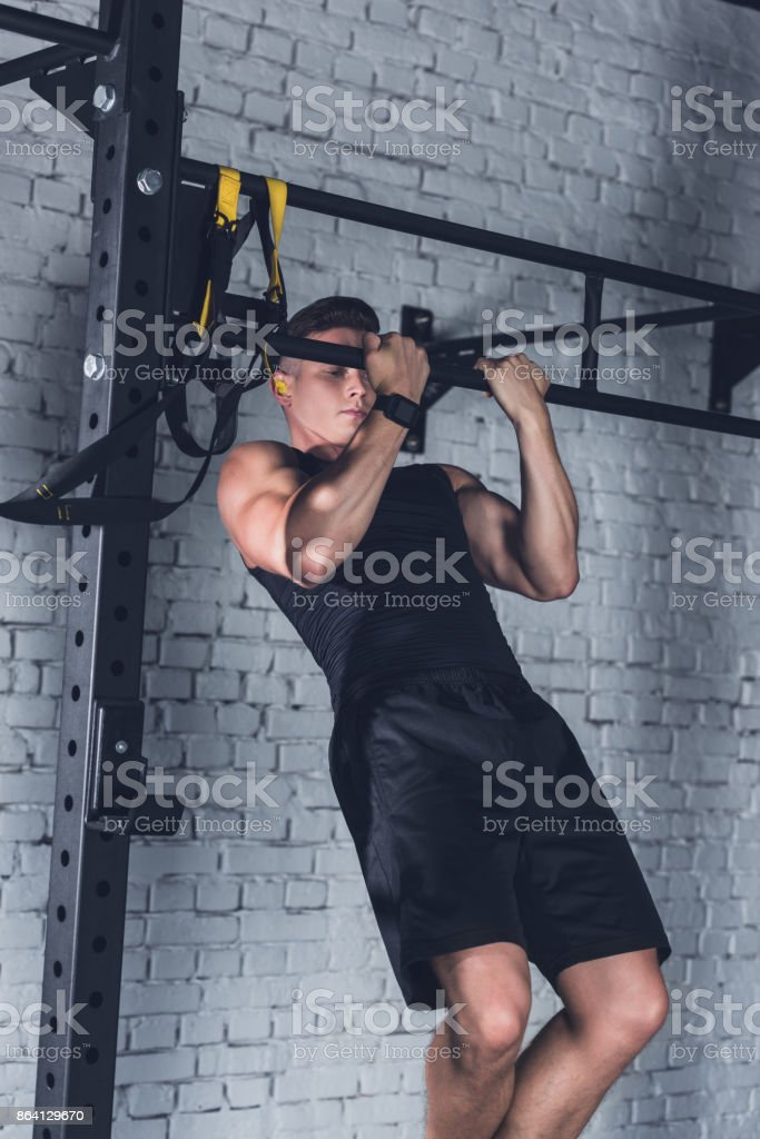 man doing pull ups royalty-free stock photo