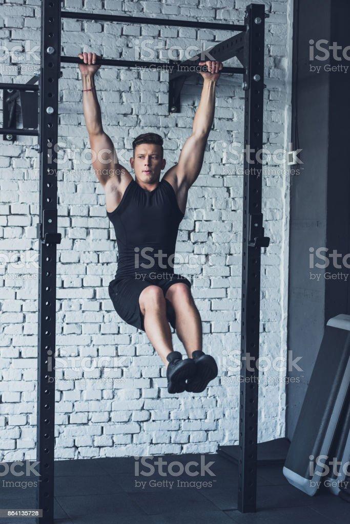man doing pull ups royalty-free stock photo