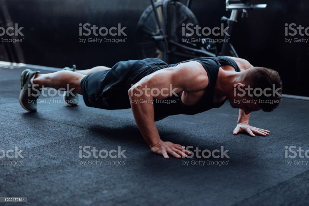 Man doing push ups in the gym