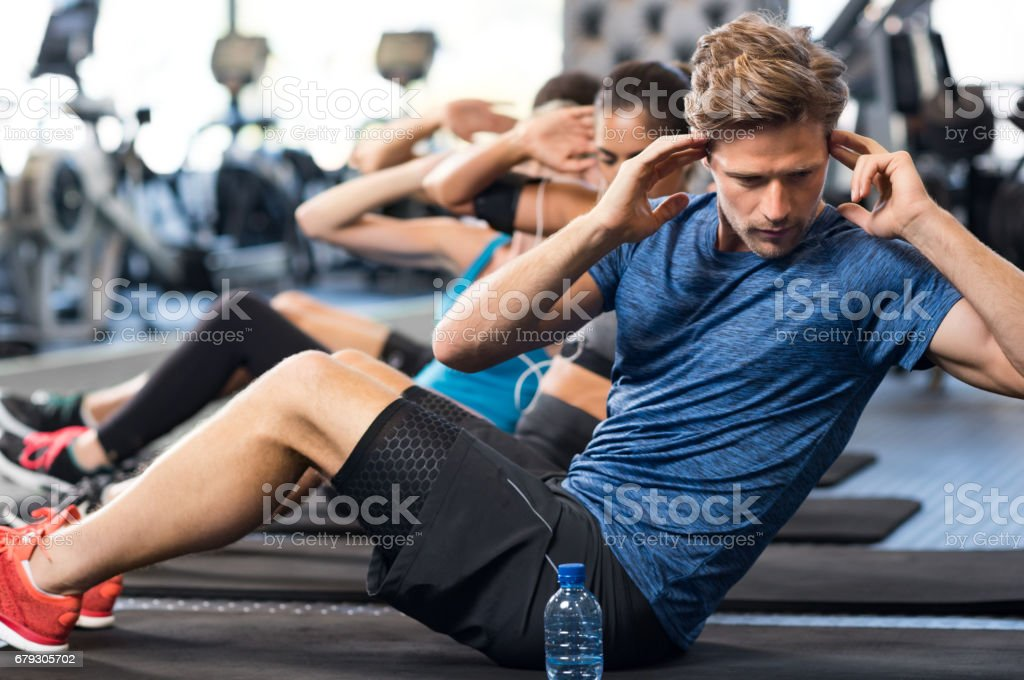 Man doing sit ups royalty-free stock photo