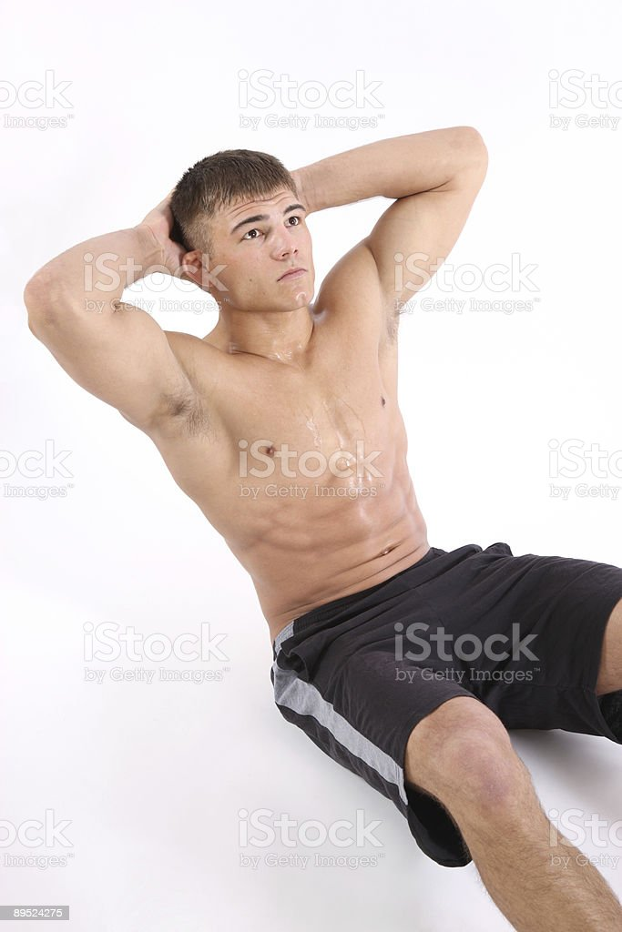 Man doing sit-ups royalty-free stock photo
