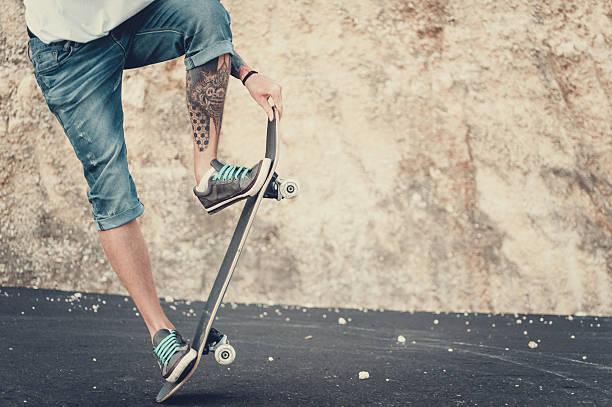 Man doing skateboard trick outdoor. stock photo