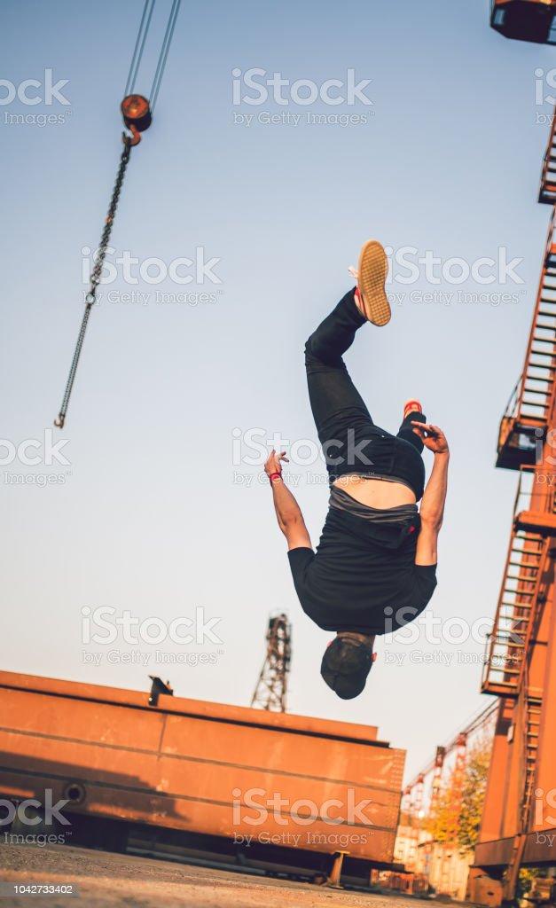 Man doing summersault stock photo