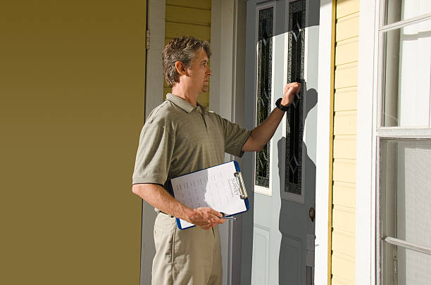 man doing survey or petition work door-to-door - vote sign stock photos and pictures