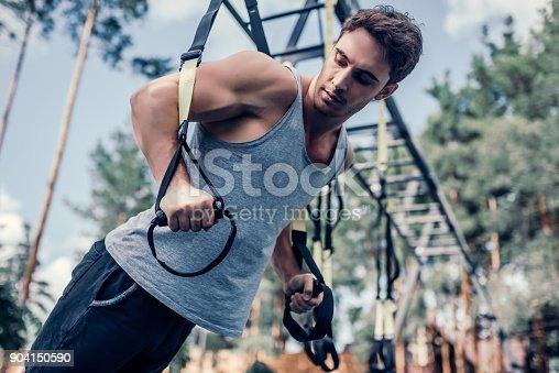904150892 istock photo Man doing suspension training 904150590
