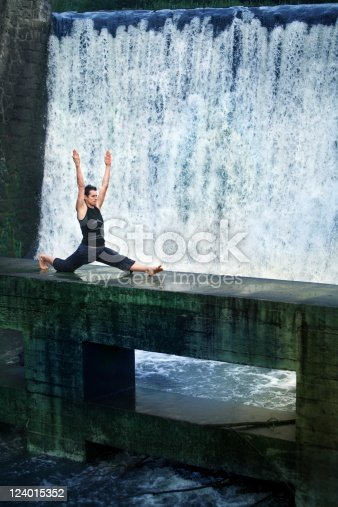 511849865 istock photo Man doing the splits in nature 124015352