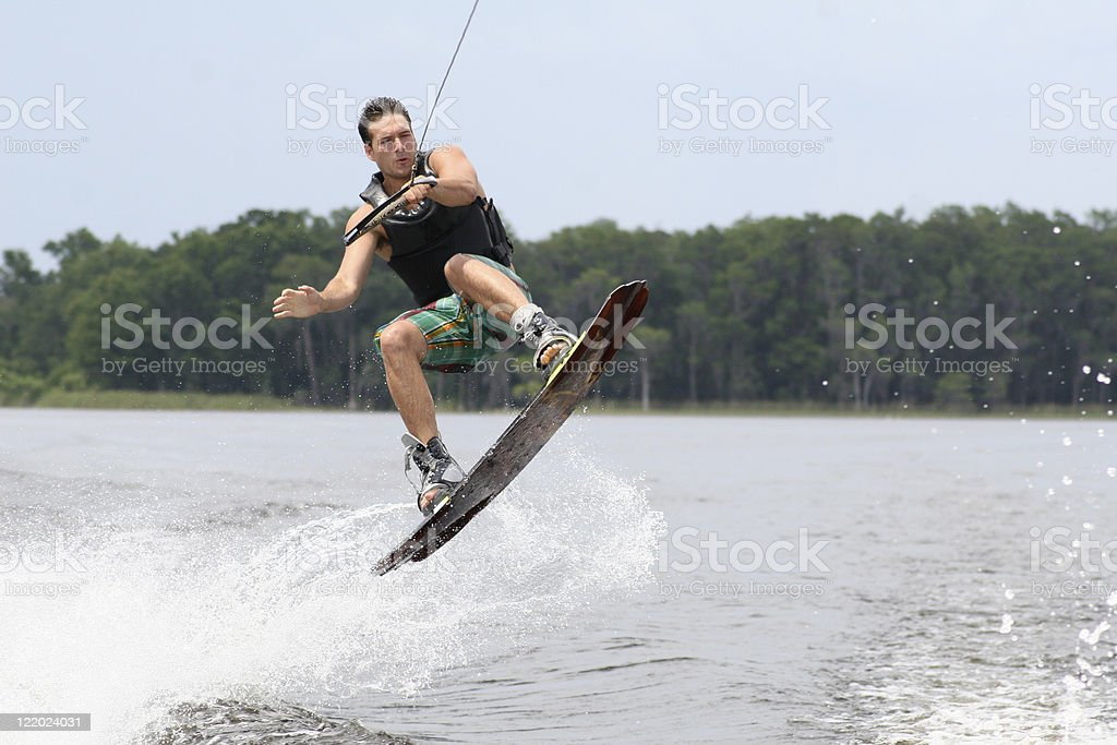 A man doing water sports outside stock photo