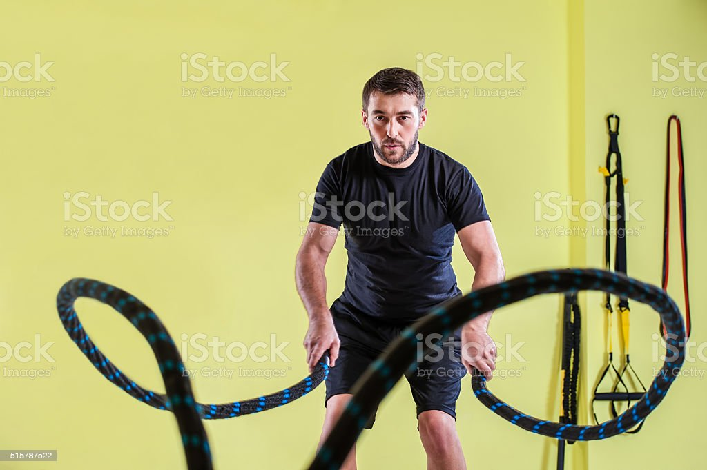 Man doing workout fitness exercise stock photo