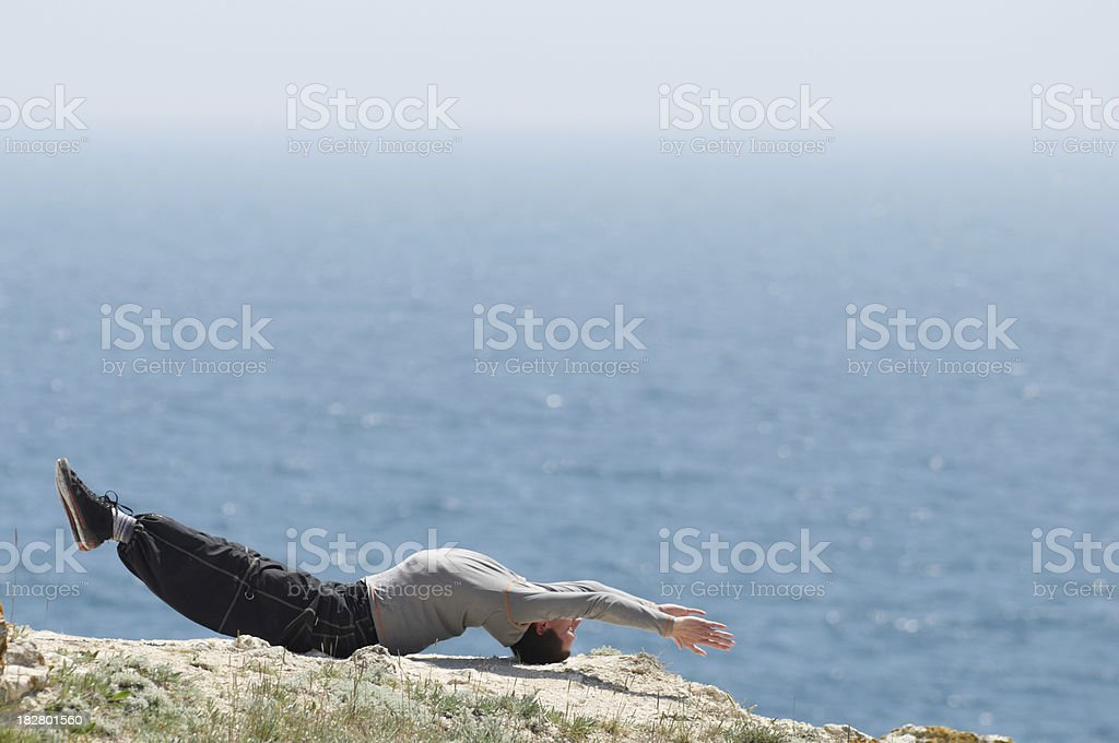 man doing yoga at sea coast royalty-free stock photo