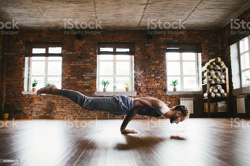 Man doing yoga in studio stock photo