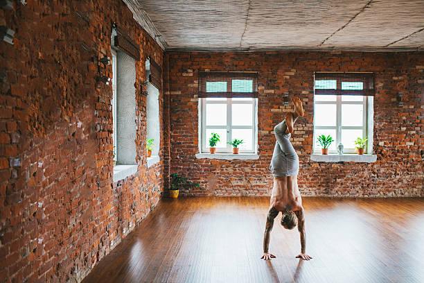man doing yoga in studio - buddhist tattoos stock-fotos und bilder