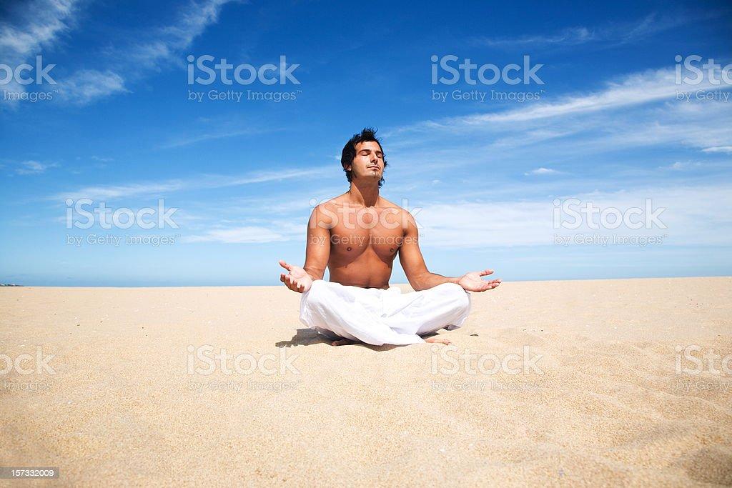 Man Doing Yoga on the Beach royalty-free stock photo