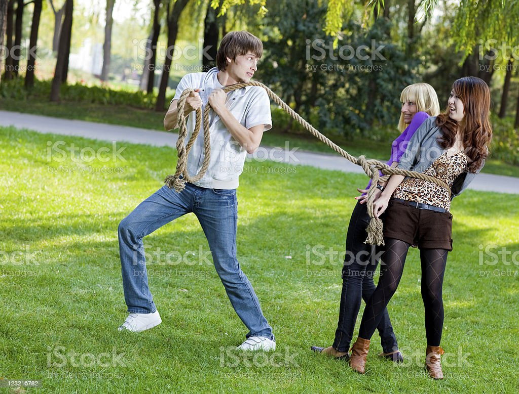 Man dragging two tied up women royalty-free stock photo