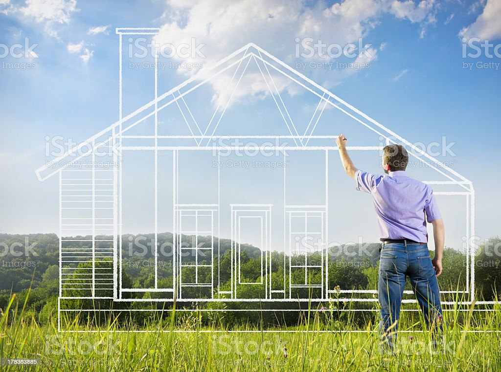 Man drawing a blue print of house in nature