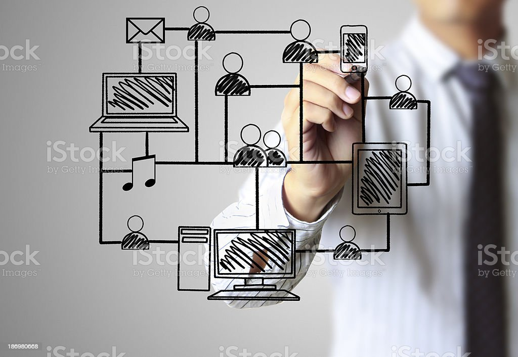 Man drawing a social network structure on glass royalty-free stock photo