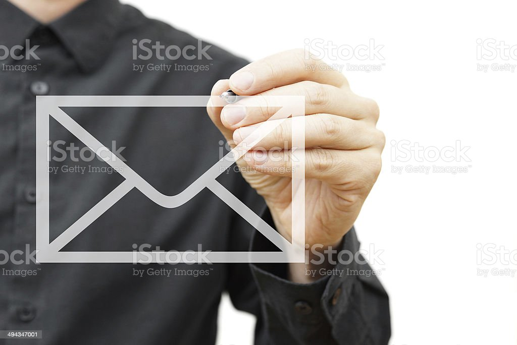 Man drawing email icon on virtual screen.  Contact information concept stock photo