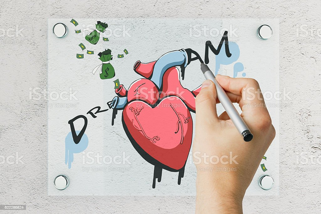 Man drawing money and heart sketch stock photo