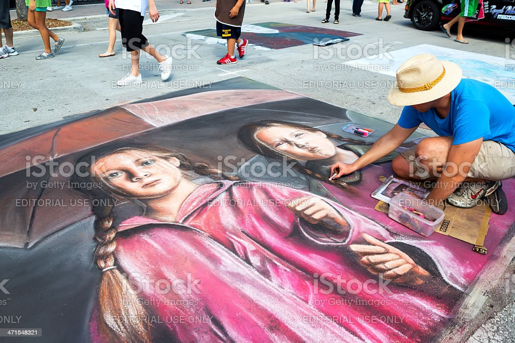 Man drawing street art portrait. stock photo