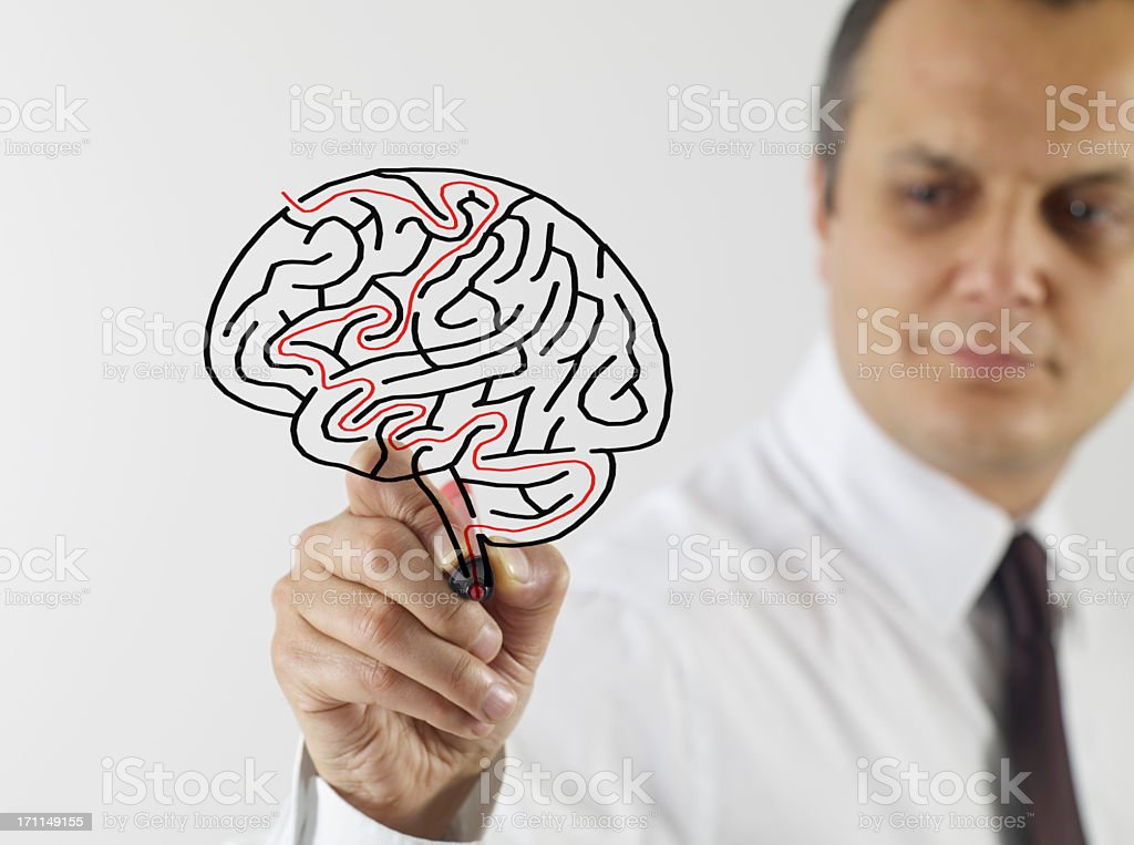 Man draws a picture of a brain with Labyrinth stock photo