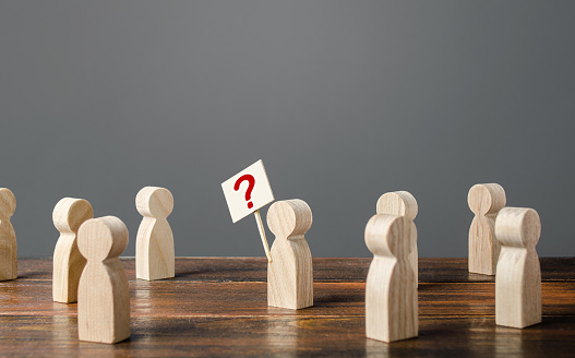 istock Man draws attention to the issue. Asking questions, searching for truth. Curiosity. Population poll survey. Social problems and the search for methods for solving them. Resonance in society. 1192266977