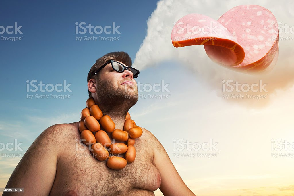 Man dreaming about sausages stock photo