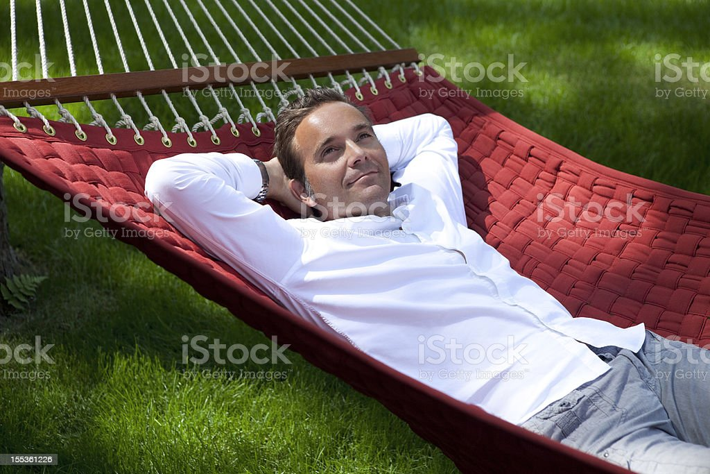 Man Dreaming outside In A Hammock royalty-free stock photo