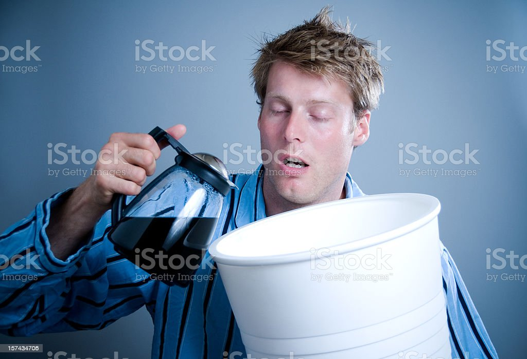 Man dreams about coffee and pours it into gigant cup stock photo