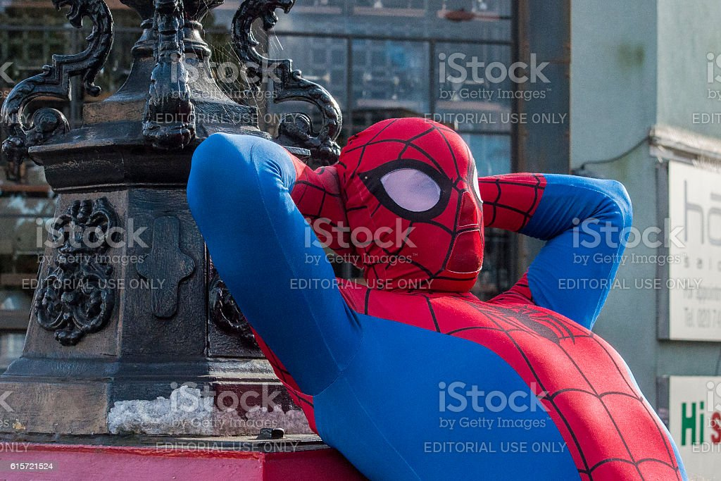 Man dressed as Spiderman resting at Camden Town, London, England. stock photo