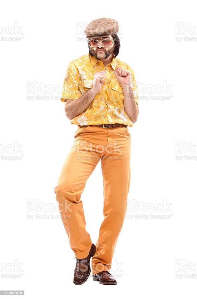 Man dressed in 70's style Hawaiian shirt disco dancing royalty-free stock photo