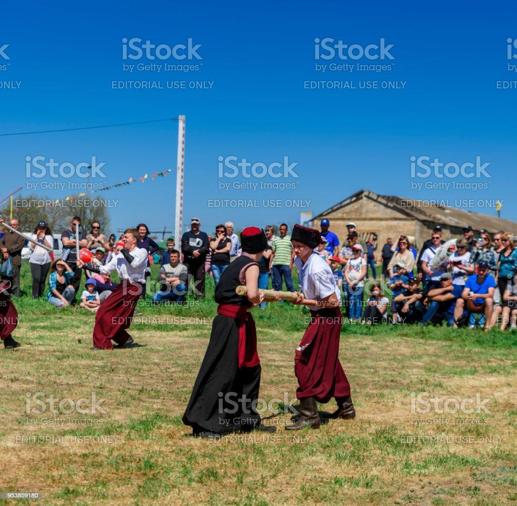 Kherson, Berislavsky district, Republicanets village, National park Kam'janska Sich , UKRAINE - APRIL 30, 2018: man dressed in a traditional Ukrainian Cossack costume stock photo