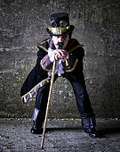 istock man dressed in steampunk, victorian clothing, dark wall background 478077522