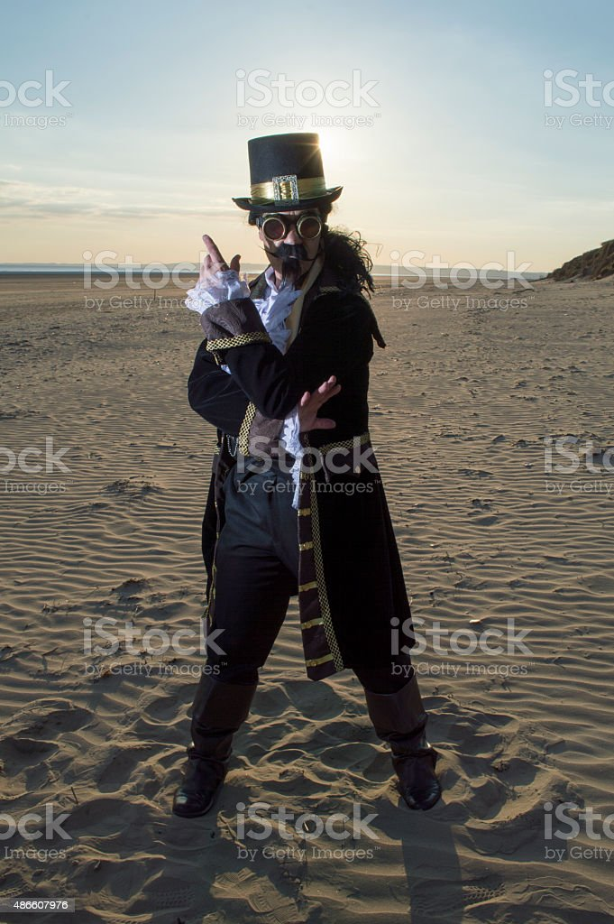 Man dressed in vintage steam punk theme on a beach stock photo