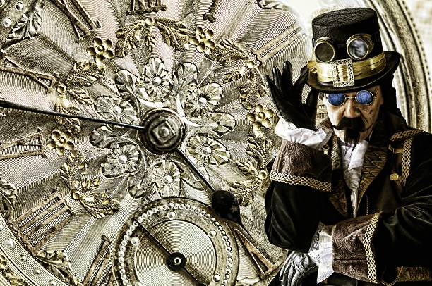 man dressed in vintage steampunk clothing with gold watch background - gothic fashion stock photos and pictures