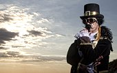 istock man dressed in vintage steampunk clothing with sunset background 478060872