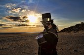 istock man dressed in vintage steampunk clothing with sunset background 478060874