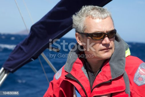 Man dressed in yachting jacket on the yacht