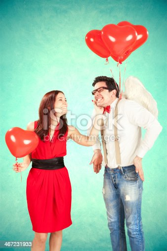 istock Man dressed like and angel approaching woman, smiling 467231933