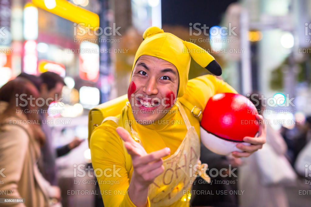 Man dressed up like Pikachu at Shibuya crosswalk in Tokyo, Japan stock photo