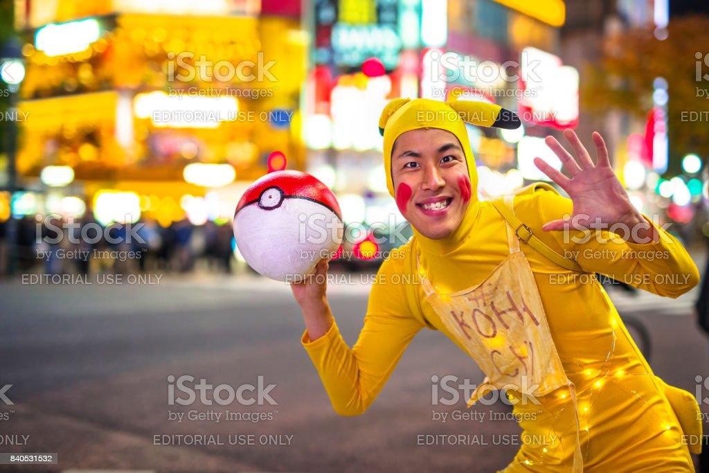 Man dressed up like Pikachu at Shibuya crosswalk in Tokyo stock photo