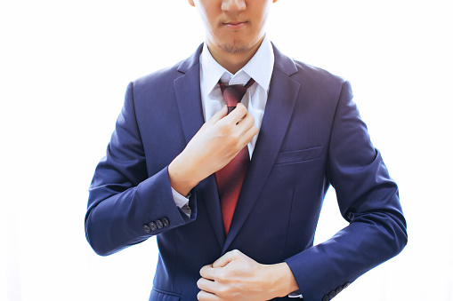 516141885 istock photo Man dressing up in formal suit over white background with copy space 861356758
