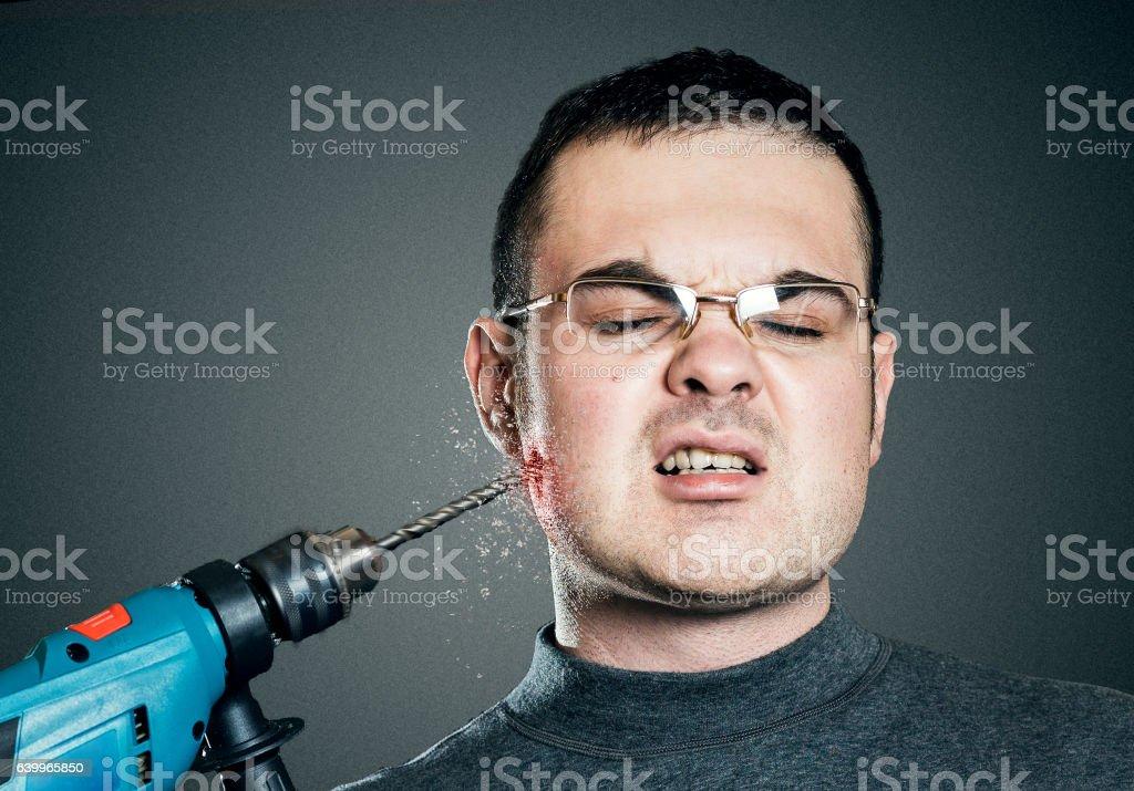 Man drills till it bleeds the cheek. Toothache, pain and stock photo