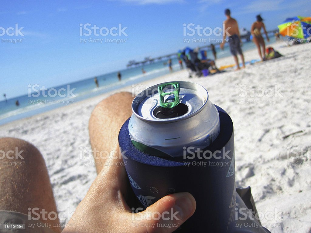 Man Drinking a Can of Beer at the Beach stock photo