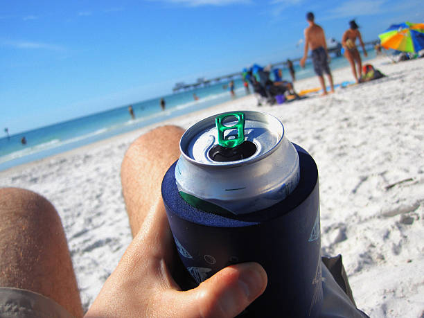 Man Drinking a Can of Beer at the Beach